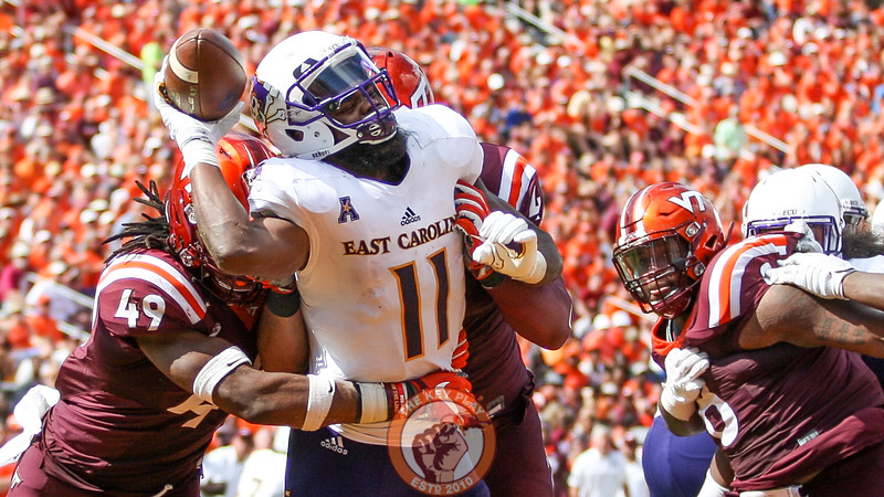 ECU WR James Summers is hit hard by DE Ken Ekanem and LB Tremaine Edmunds on a direct snap inside the ECU endzone.  (Mark Umansky/TheKeyPlay.com)