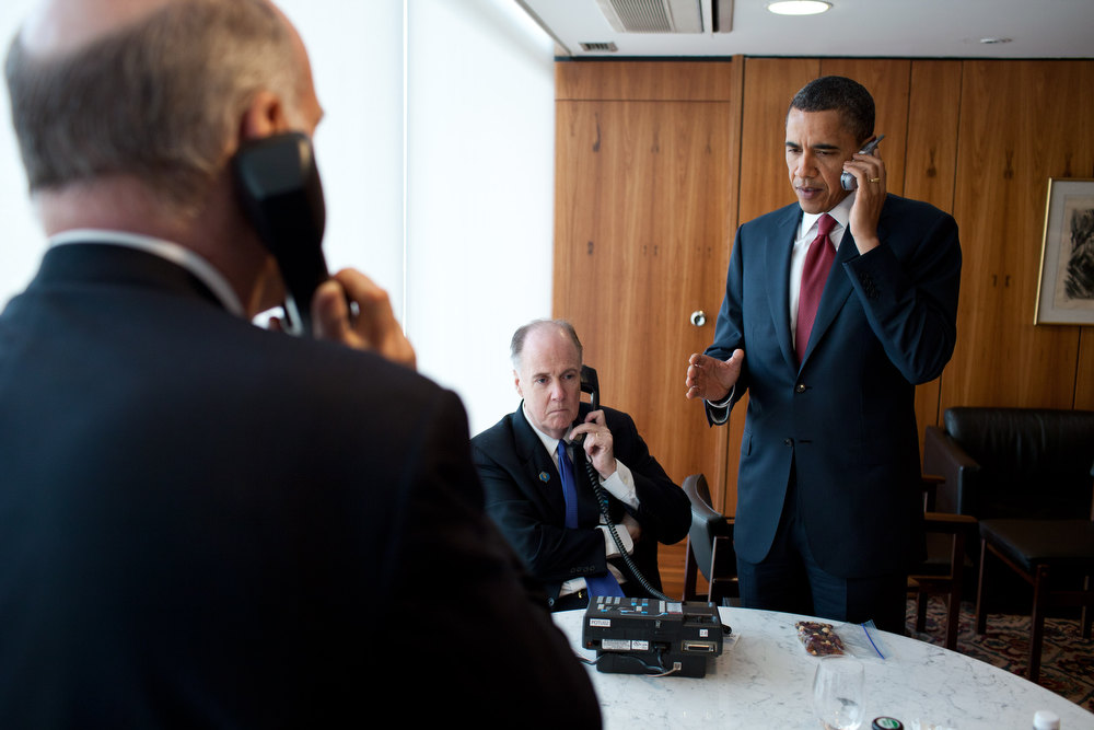 Description of . President Barack Obama phone call briefing on Libya at Palacio Do Planalto in Brasilia, Brazil, March 19, 2011. Attending the briefing are: National Security Advisor Tom Donilon; Chief os Staff Bill Daley, and Ben Rhodes, Deputy National Security Advisor for Strategic Communication. (Official White House Photo by Pete Souza)