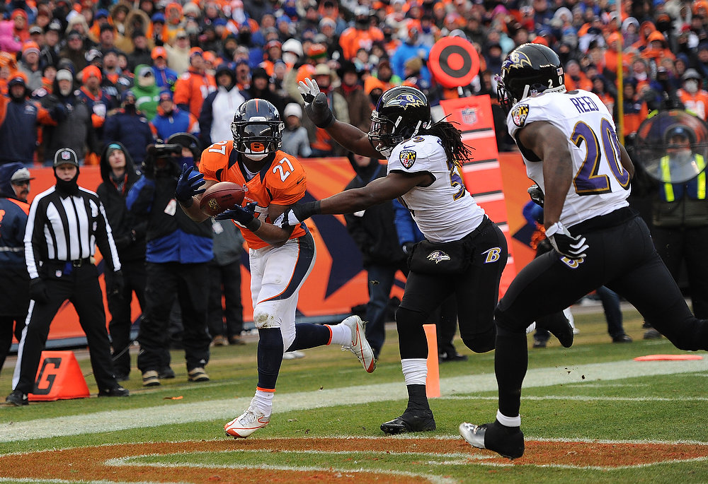 Description of . Denver Broncos running back Knowshon Moreno (27) catches a 14-yard pass for a touchdown in the second quarter. The Denver Broncos vs Baltimore Ravens AFC Divisional playoff game at Sports Authority Field Saturday January 12, 2013. (Photo by Joe Amon,/The Denver Post)