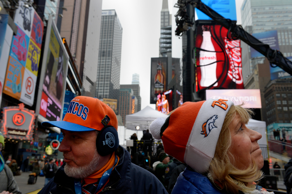 """. Broncos fans Judy Engle of Wheat Ridge, CO, right, and Lenny Mattingly, Nashville, TN, visiting Times Square in New York, NY January 31, 2014. The NFL has transformed 13 blocks of Broadway into Super Bowl Boulevard before Sundays Super Bowl between the Denver Broncos and Seattle Seahawks. Mattingly admitted being a Titans fan but said, \""""This week I\'m a Broncos fan.\""""  (Photo By Craig F. Walker / The Denver Post)"""