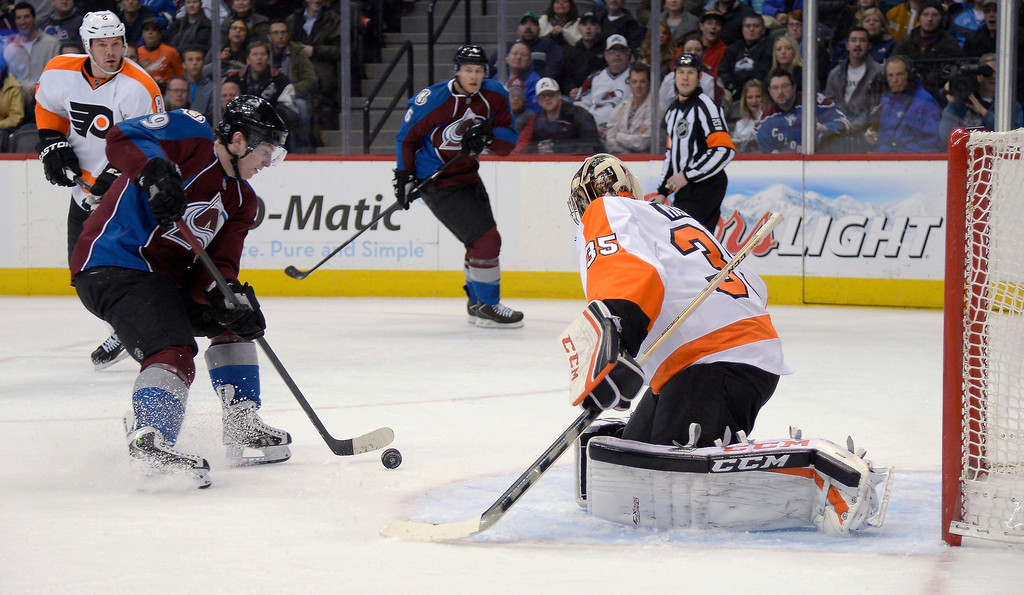 . Colorado Avalanche center Matt Duchene (9) can\'t control the puck in front of Philadelphia Flyers goalie Steve Mason (35) during the first period January 2, 2014 at Pepsi Center. (Photo by John Leyba/The Denver Post)