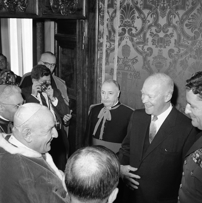 . Pope John XXIII speaks to Mrs. Barbara Eisenhower, wife of John Eisenhower (who stands right of her), the U.S. President�s son and aide, while President Dwight D. Eisenhower stands left, during an audience granted in the Pontiff�s private library in the Vatican Palace on Dec. 6, 1959 in Vatican. (AP Photo/Robert Schutz)
