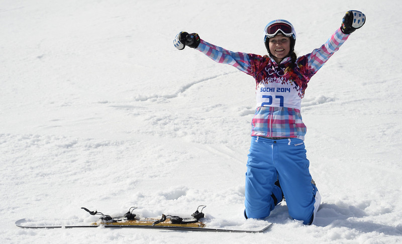. Bronze Medallist, Russia\'s Alena Zavarzina celebrates in the Women\'s Snowboard Parallel Giant Slalom Final at the Rosa Khutor Extreme Park during the Sochi Winter Olympics on February 19, 2014.  FRANCK FIFE/AFP/Getty Images