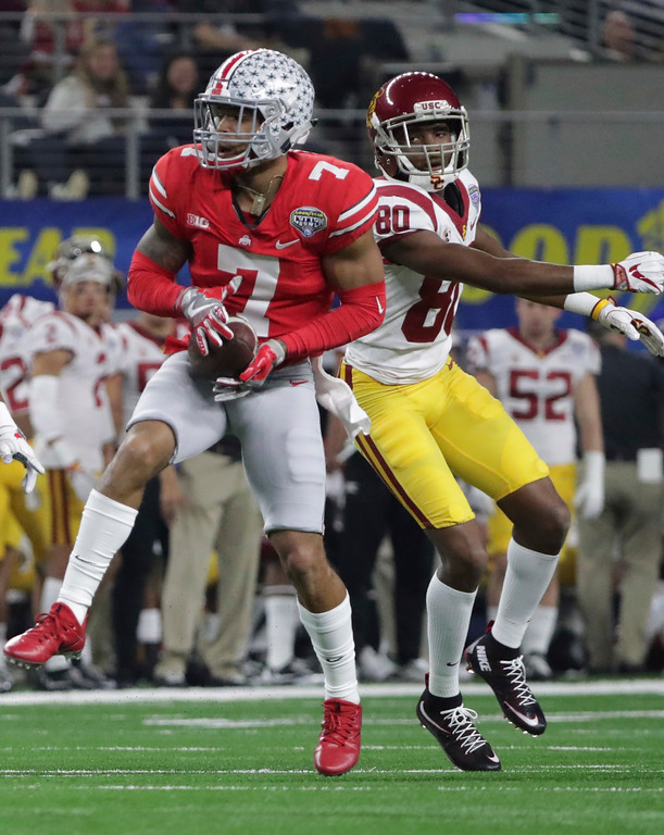 . Ohio State safety Damon Webb (7) intercepts a pass in front of Southern California wide receiver Deontay Burnett (80) during the first half of the Cotton Bowl NCAA college football game in Arlington, Texas, Friday, Dec. 29, 2017. Webb returned the interception for a touchdown. (AP Photo/LM Otero)