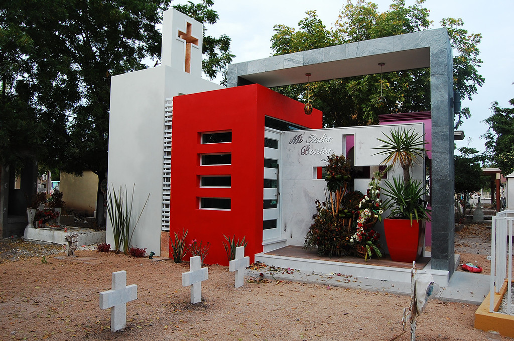 ". This Jan. 28, 2013 photo shows the mausoleum where beauty queen Maria Susana Flores Gamez is buried, in a cemetery in Guamuchil, Mexico. Susy was only 4 when her mother signed her up for a pageant she had organized herself. The child won, and was crowned ""Queen of the Red Cross.\"" It was an exciting moment in a young life soon marred by violence. Two years later, Susy\'s father was killed after his car was sprayed with bullets - not an uncommon occurrence in Sinaloa. He was 35. Susy was buried with her father in a mausoleum that her mother expanded for her, adding glass lamps and marbled walls.  (AP Photo/Adriana Gomez)"