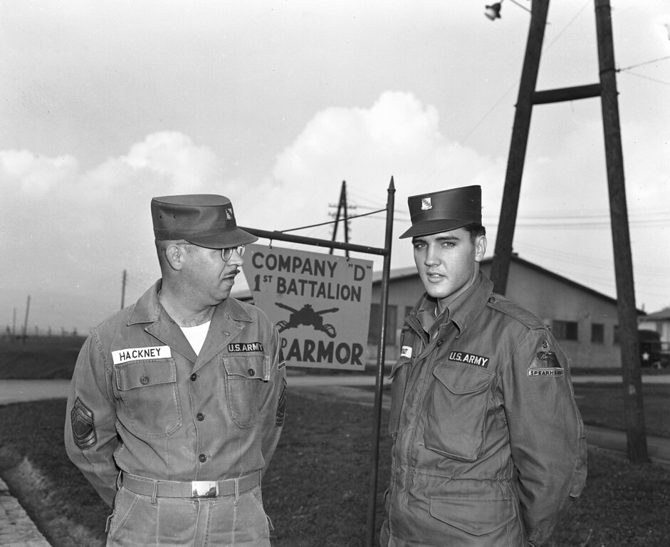 . Elvis Presley, the American rock and roll singer-turned soldier, poses with his first sergeant, Master Sgt. Edward Hackney of Philadelphia, in the Friedberg, West Germany barracks, Oct. 3, 1958. Presley has been assigned to the Third Armored (Spearhead) Division at Friedberg. (AP Photo/Walter Lindlar)