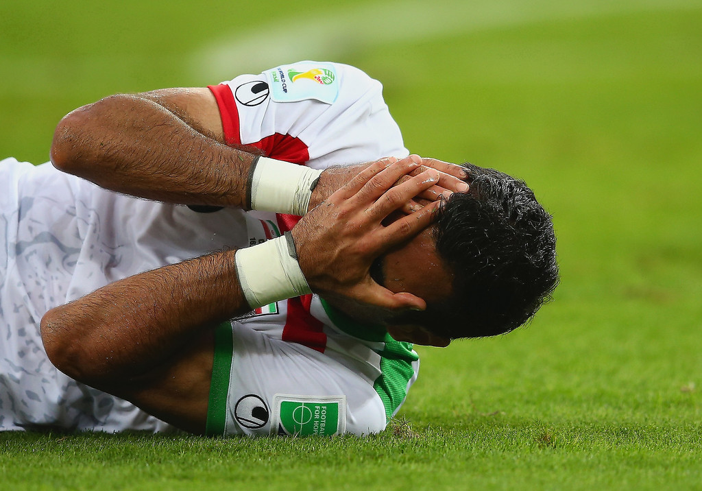 . Mehrdad Pooladi of Iran reacts on the field during the 2014 FIFA World Cup Brazil Group F match between Iran and Nigeria at Arena da Baixada on June 16, 2014 in Curitiba, Brazil.  (Photo by Julian Finney/Getty Images)