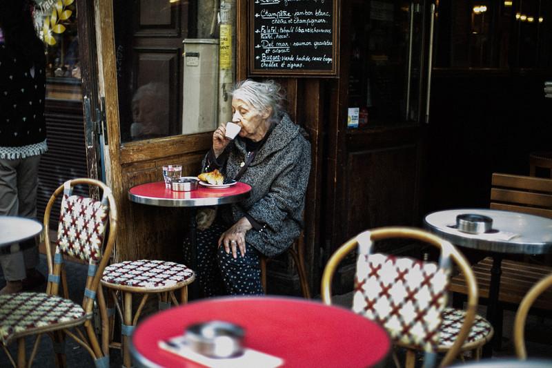 older lady drinking espresso.jpg