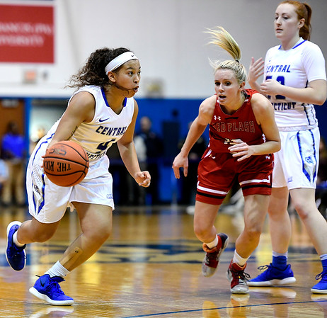 1/19/2019 Mike Orazzi | Staff CCSU's Kiana Patterson (4) and Saint Francis University's Sam Sabino (13) during Saturday's basketball game in New Britain.
