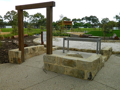 timber post and sandstone ruin with water play and sandpit