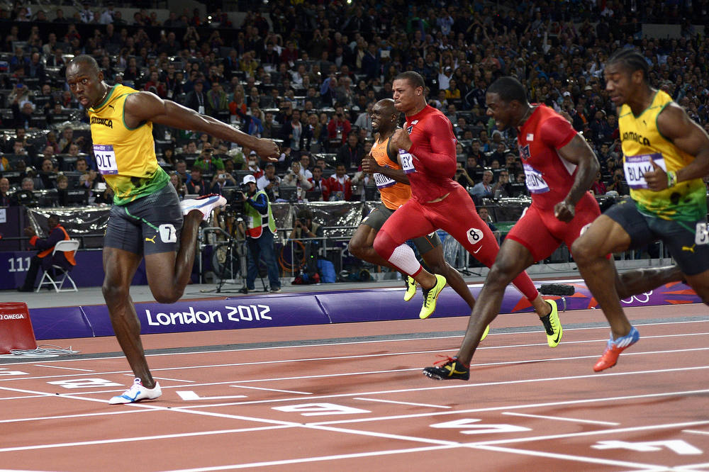 Description of . Jamaica's Usain Bolt wins the men's 100m final at the athletics event during the London 2012 Olympic Games on August 5, 2012 in London.  AFP PHOTO / ADRIAN DENNIS/AFP/Getty Images