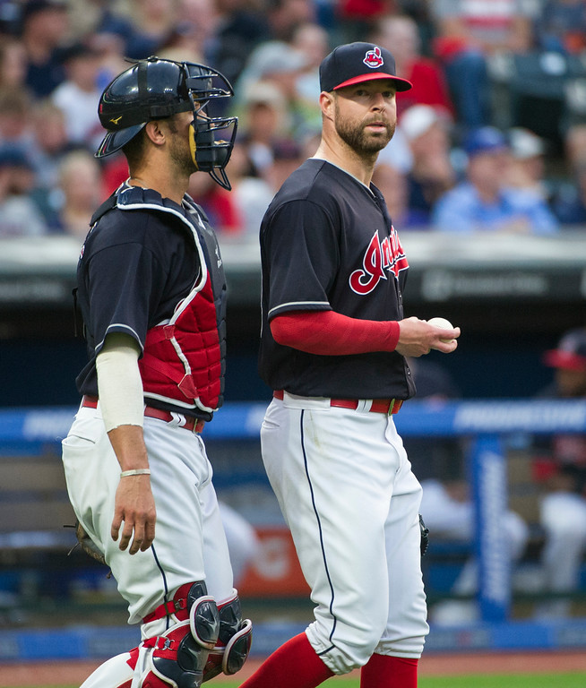 . Cleveland Indians starting pitcher Corey Kluber and catcher Yan Gomes, talk during a baseball game against the Chicago White Sox in Cleveland, Friday, June 9, 2017. (AP Photo/Phil Long)