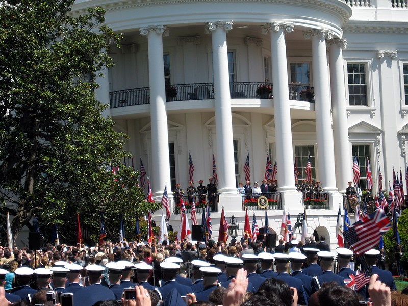 First Lady Laura Bush, Prince Philip, Queen Elizabeth II, and President George W. Bush greet the crowd from the South Portico Balcony of the White House