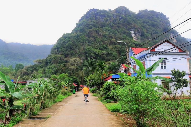 Cycling through a small village on Cat Ba Island - Halong Bay