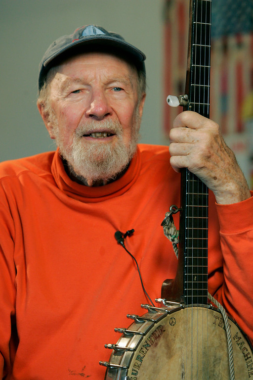 ". File- This May 5, 2006, file photo shows Pete Seeger in Beacon, N.Y. The earnest troubadour who either co-wrote or popularized canonical songs like ""If I Had a Hammer\"" and \""John Henry\"" has become something like America\'s folkie emeritus. He\'s back on the charts now, sort of, with the release of \""We Shall Overcome: The Seeger Sessions,\"" featuring Bruce Springsteen\'s full-throated versions of standards performed by Seeger.   The American troubadour, folk singer and activist Seeger  died Monday Jan. 27, 2014, at age 94.  (AP Photo/Frank Franklin II, File)"