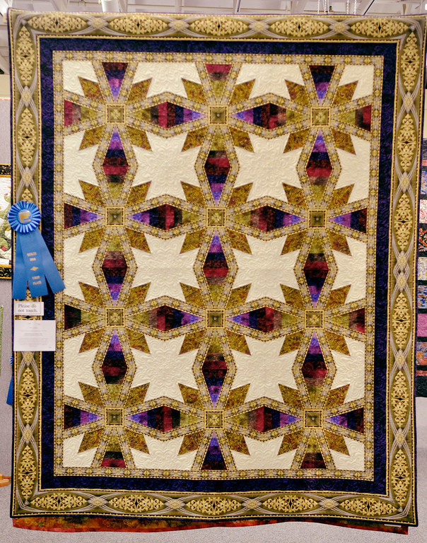". Jeff Forman/JForman@News-Herald.com ""Coraline\"" by Michele Howell, of Madison, won first place in the individual pieced bed quilt category."