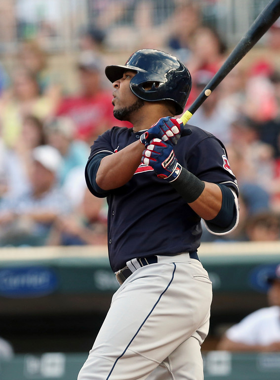 . Cleveland Indians\' Edwin Encarnacion watches his RBI double off Minnesota Twins pitcher Jake Odorizzi during the first inning of a baseball game Thursday, May 31, 2018, in Minneapolis. (AP Photo/Jim Mone)