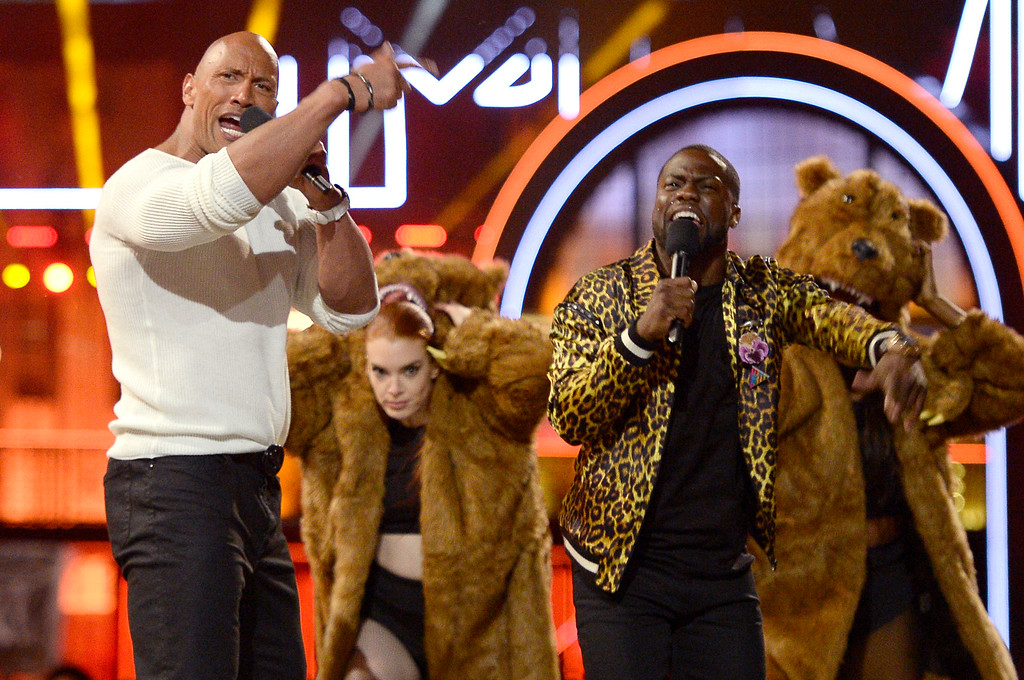 . Hosts Dwayne Johnson, left, and Kevin Hart perform a tribute to the 25th anniversary of the MTV Movie Awards at Warner Bros. Studio on Saturday, April 9, 2016, in Burbank, Calif. (Kevork Djansezian/Pool Photo via AP)
