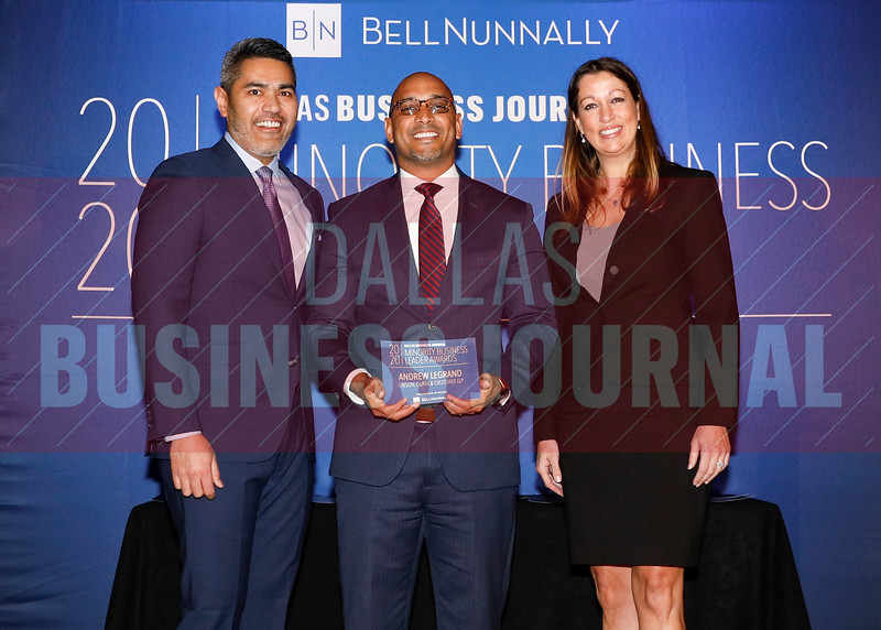 Andrew LeGrand, Partner,Gibson, Dunn & Crutcher LLP, (center) accepts her Minority Business Leader award from Chandhok, (left) and Mathes.