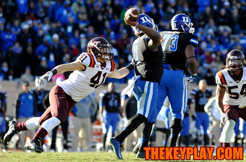 Virginia Tech linebacker Derek Di Nardo (41) grabs Duke quarterback Anthony Boone (7) as he attempts a pass. (Michael Shroyer/ Thekeyplay.com)