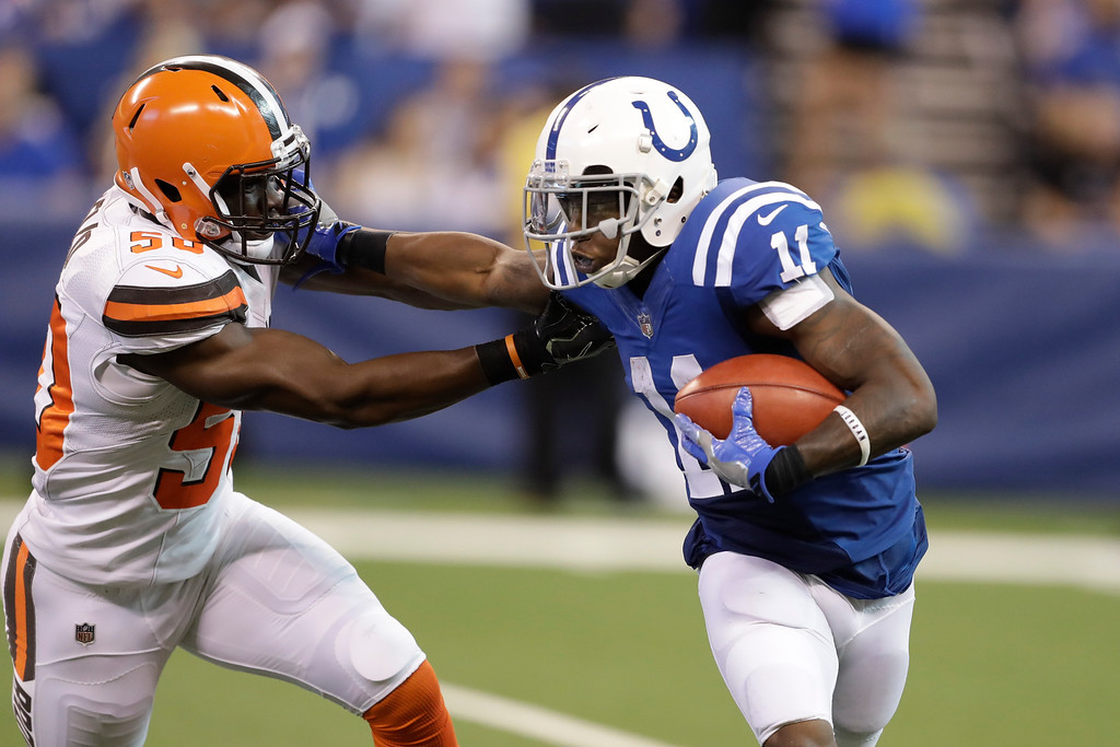 . Indianapolis Colts wide receiver Quan Bray (11) holds off Cleveland Browns linebacker B.J. Bello (50) on a punt return during the second half of an NFL football game in Indianapolis, Sunday, Sept. 24, 2017. (AP Photo/Darron Cummings)