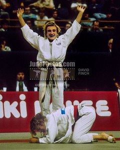 1989 Belgrade Worlds 891014A2519:  Karen Briggs of Great Britain triumphantly rises with out stretched arms after beating Cecille Nowak of France to reach the final ...