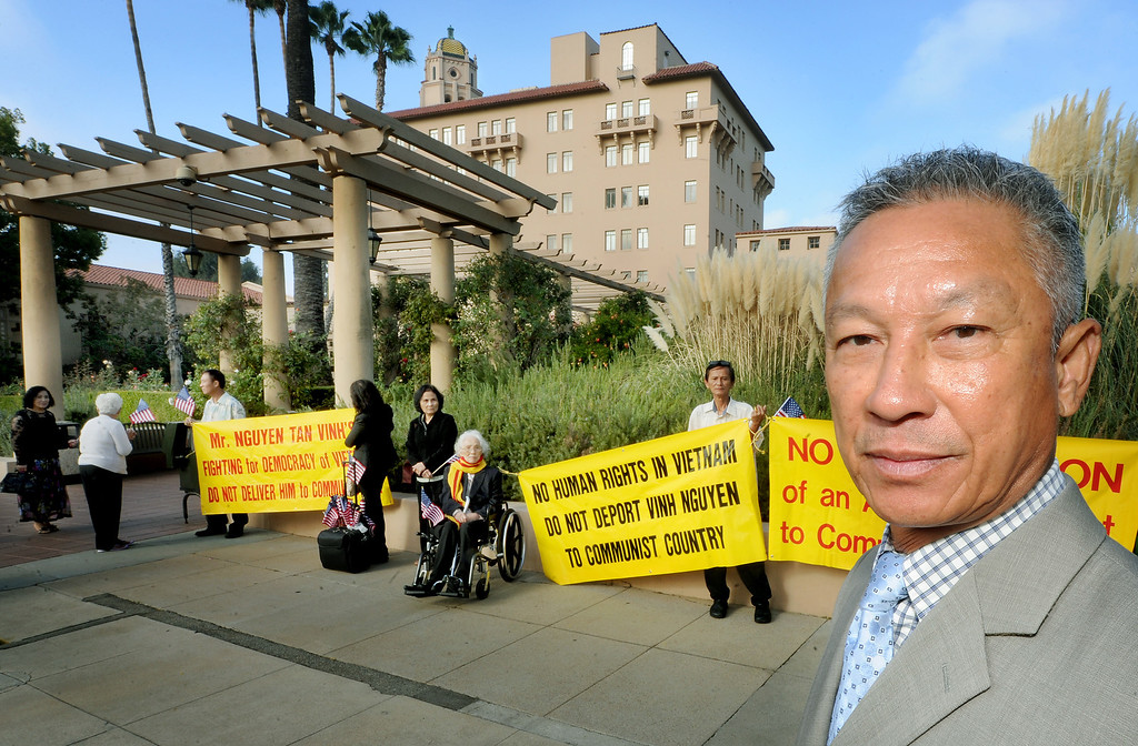 . About 125 Vietnamese-Americans staged a demonstration in front of the U.S. Ninth Circuit Appellate Court in Pasadena Tuesday, October 8, 2013, to request that the order of deportation issued against Vinh Nguyen, right, an Anti-Communist Hero is overturned. Nguyen violated a law, a U.S. Immigration Court on August 5, 2009, made the decision to deport him. The decision was appealed. Protesters want to seek political asylum for Nguyen, whose life, they said, will be endangered if he returns to Vietnam.(Walt Mancini/Pasadena Star-News)