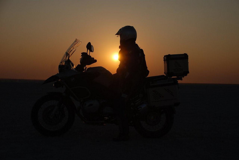 R1200GS Reflection - Photo by Gillian Hine - http://www.unicornpictures.ifp3.com Sunset, Botswana, South Africa http://www.gsadventures.co.za