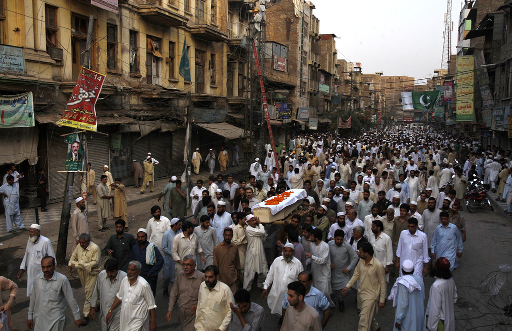 . Pakistani relatives and mourners carry the body of a man who was killed in a car bomb explosion, during his funeral procession in Peshawar, Pakistan, Sunday, Sept. 29, 2013. (AP Photo/Mohammad Sajjad)