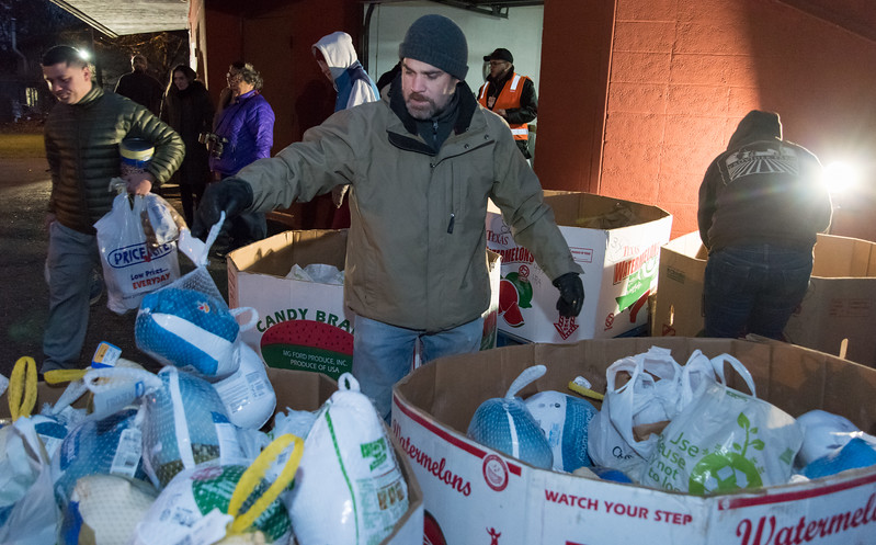 11/20/17  Wesley Bunnell | Staff  HRA held its annual turkey distribution at the New Britain Food & Resource Center on Monday afternoon with help from workers and volunteers. HRA employee and food drive volunteer Travis Nichols sorts through turkey's ready for distribution.