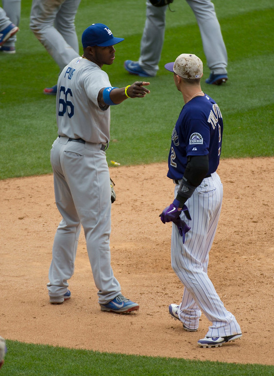 . Colorado Rockies shortstop Troy Tulowitzki (2) talks with Los Angeles Dodgers right fielder Yasiel Puig (66) after the game July 6, 2014 at Coors Field. (Photo by John Leyba/The Denver Post)