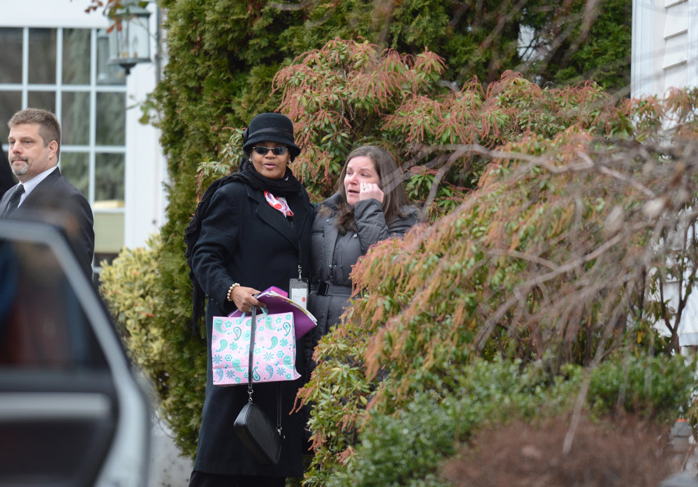 Description of . Mourners arrive for Noah Pozner's funeral December 17, 2012 at the Abraham L. Green and Son Funeral Home in Fairfield, Connecticut. Pozner, a six year-old Jewish boy who, along with 19 other classmates and 6 teachers was murdered by a lone gunman December 14 at the Sandy Hook Elementary School in Newtown, Connecticut.  AFP PHOTO / Don  EMMERT/AFP/Getty Images