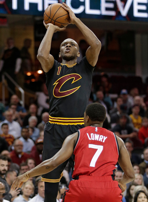 . Cleveland Cavaliers\' James Jones (1) shoots over Toronto Raptors\' Kyle Lowry (7) in the first half of an NBA basketball game, Wednesday, April 12, 2017, in Cleveland. (AP Photo/Tony Dejak)