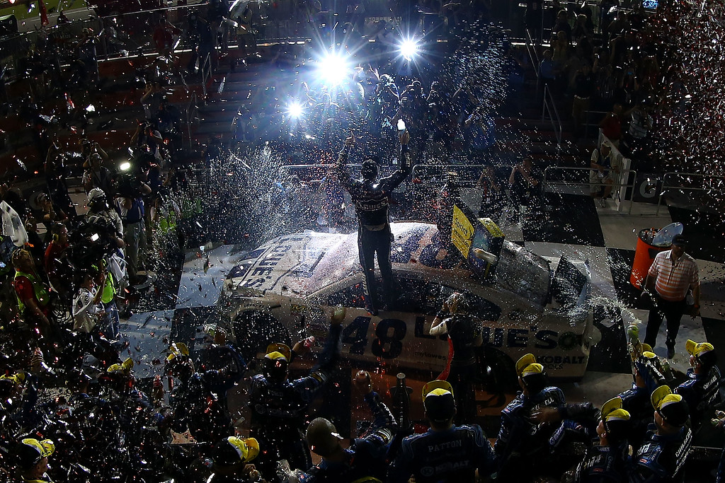 . DAYTONA BEACH, FL - JULY 06:  Jimmie Johnson, driver of the #48 Lowe\'s Dover White Chevrolet, celebrates with his crew in victory lane after winning the NASCAR Sprint Cup Series Coke Zero 400 at Daytona International Speedway on July 6, 2013 in Daytona Beach, Florida.  (Photo by Tom Pennington/Getty Images)