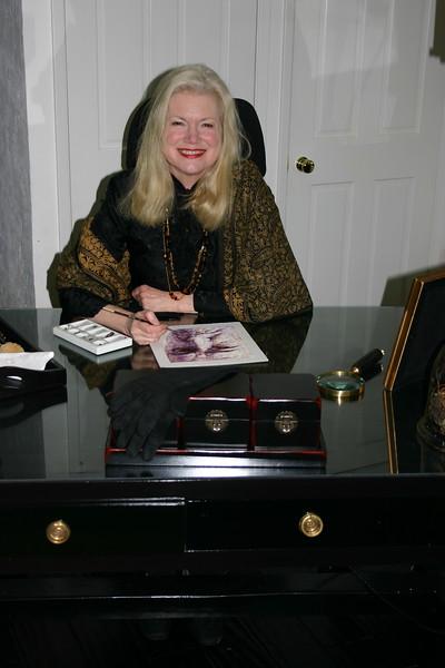Morgan at her desk painting watercolor