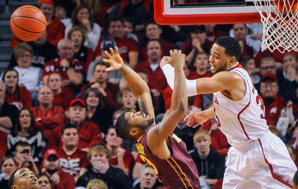 . Nebraska Cornhuskers forward Walter Pitchford (35) and Minnesota Golden Gophers guard Maverick Ahanmisi (13) go for a rebound. (AP Photo/Dave Weaver)