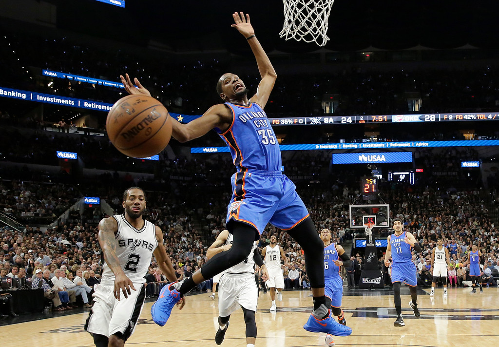 . Oklahoma City Thunder forward Kevin Durant (35) is fouled by San Antonio Spurs forward Kawhi Leonard (2) as he drives to the basket during the first half in Game 5 of a second-round NBA basketball playoff series, Tuesday, May 10, 2016, in San Antonio. (AP Photo/Eric Gay)