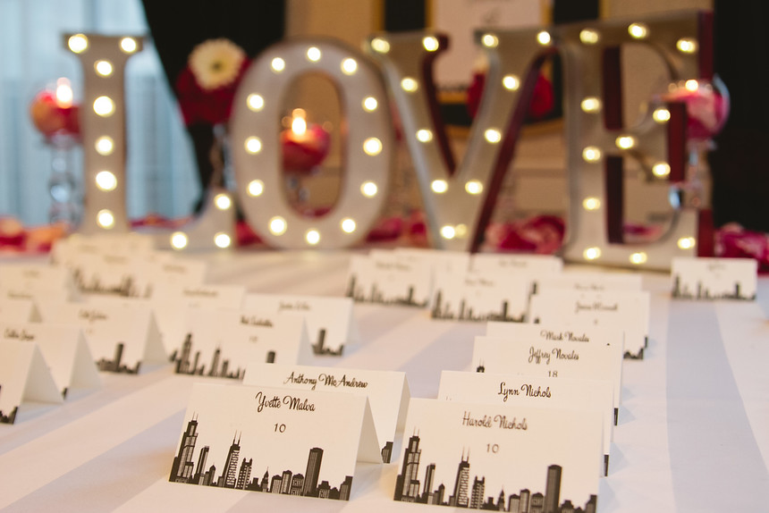 place cards in front of love sign