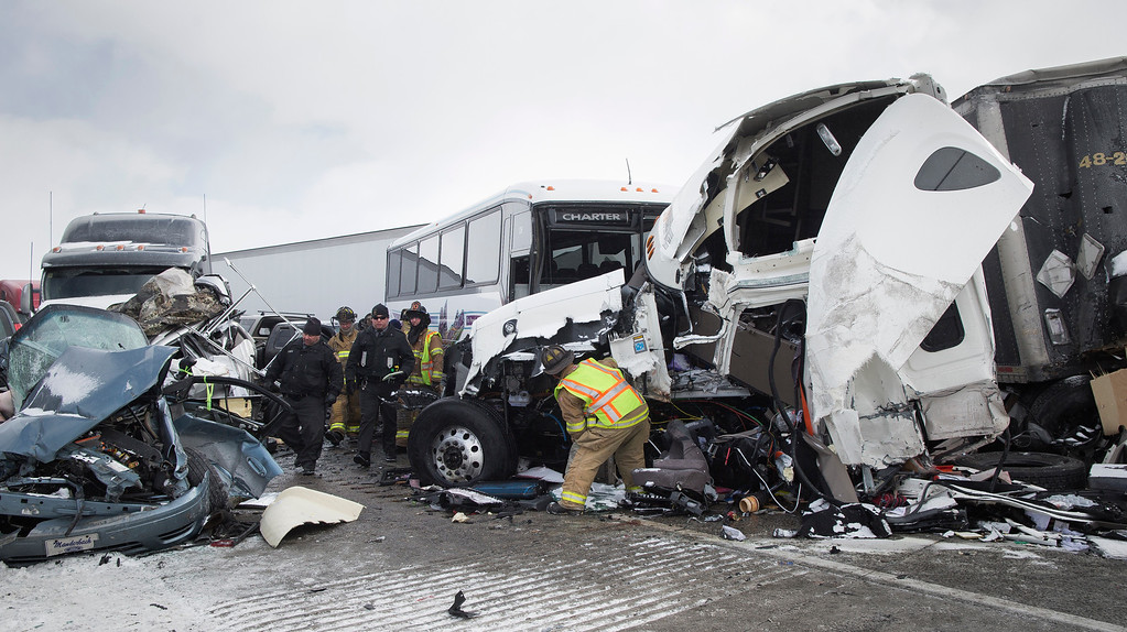. Emergency personnel work at the scene of a fatal crash near Fredericksburg, Pa., Saturday, Feb. 13, 2016. The pileup left tractor-trailers, box trucks and cars tangled together across several lanes of traffic and into the snow-covered median. (Daniel Zampogna/PennLive.com via AP)