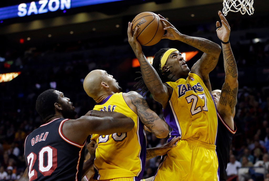 . Los Angeles Lakers forward Jordan Hill (27) goes to the basket against the Miami Heat during the third quarter of an NBA basketball game in Miami, Thursday, Jan. 23, 2014. The Heat won 109-102. (AP Photo/Alan Diaz)