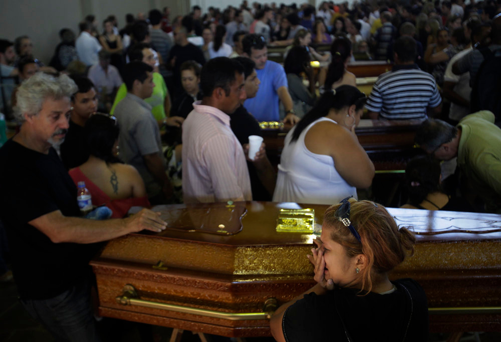 . Relatives of victims of the fire at Boate Kiss nightclub attend a collective wake in the southern city of Santa Maria, 187 miles (301 km) west of the state capital Porto Alegre, January 27, 2013. The nightclub fire killed at least 232 people in Santa Maria early on Sunday when a band\'s pyrotechnics show set the building ablaze and fleeing partygoers stampeded toward blocked and overcrowded exits in the ensuing panic, officials said. REUTERS/Ricardo Moraes