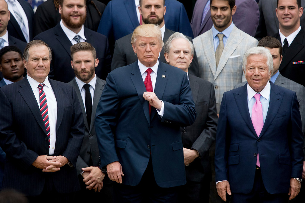 . President Donald Trump, flanked by New England Patriots head coach Bill Belichick, left, and owner Robert Kraft, right, poses with members of the Patriots during a ceremony on the South Lawn of the White House in Washington, Wednesday, April 19, 2017, where he  honored the Super Bowl Champion New England Patriots for their Super Bowl LI victory. (AP Photo/Andrew Harnik)