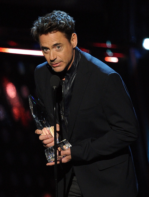 . LOS ANGELES, CA - JANUARY 08:  Actor Robert Downey Jr. accepts the Favorite Action Movie Actor award onstage at The 40th Annual People\'s Choice Awards at Nokia Theatre L.A. Live on January 8, 2014 in Los Angeles, California.  (Photo by Kevin Winter/Getty Images)