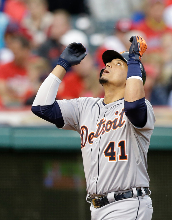 . Detroit Tigers\' Victor Martinez looks up after hitting a two-run home run off Cleveland Indians starting pitcher Corey Kluber in the fourth inning of a baseball game, Friday, June 20, 2014, in Cleveland. Miguel Cabrera scored. (AP Photo/Tony Dejak)