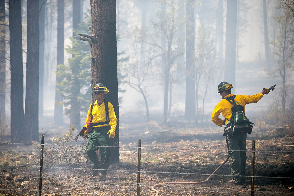 . Black Timber Engine 52 firefighters work to contain the Slide Fire north of Oak Creek Overlook in Flagstaff, Ariz., Thursday, May 22, 2014. (AP Photo/The Arizona Republic, Michael Schennum)