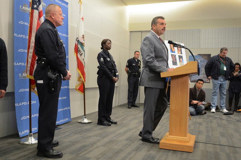 . LAPD police chief Charlie Beck updates the media about the ongoing investigation into the Dorner case.  At left is LAPD Captain Phil Tingirides and Sergeant Emada Tingirides who were officers targeted by Dorner.  Photo by David Crane/Staff Photographer
