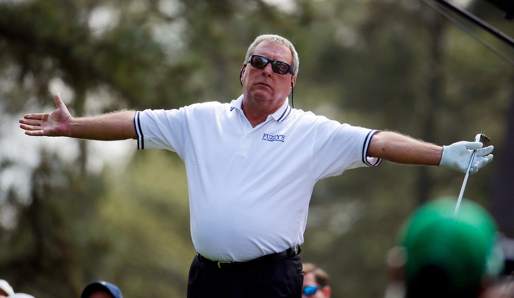 . Fuzzy Zoeller watches his tee shot on the first hole during the par three competition at the Masters golf tournament Wednesday, April 9, 2014, in Augusta, Ga. (AP Photo/Darron Cummings)