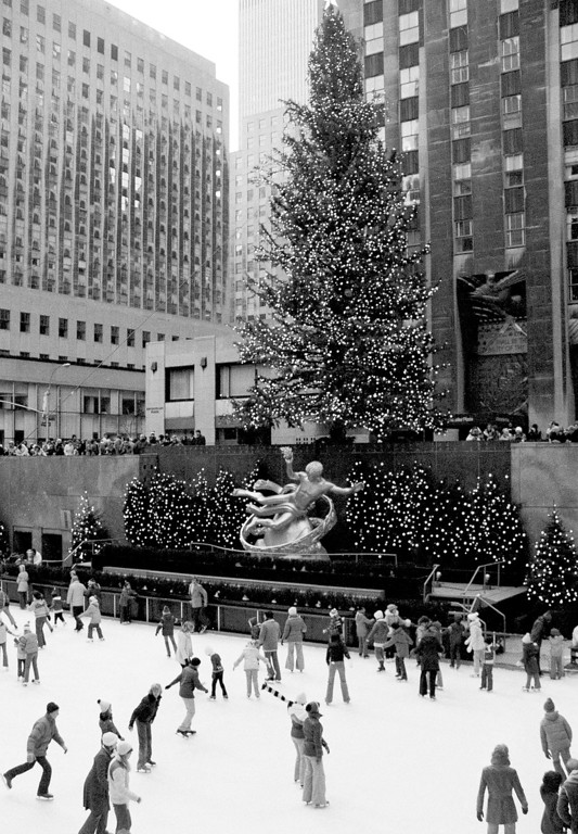 . Ice skaters glide in the rink below the Rockefeller Center Christmas tree in New York, Dec. 5, 1978, after it was lit. (AP Photo/Ron Frehm)