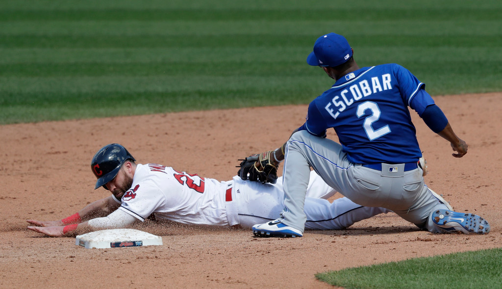 . Cleveland Indians\' Jason Kipnis slides safely into second base as Kansas City Royals\' Alcides Escobar lets the ball get by in the sixth inning of a baseball game, Wednesday, Sept. 5, 2018, in Cleveland. (AP Photo/Tony Dejak)