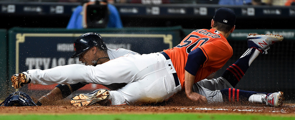 . Cleveland Indians\' Francisco Lindor, left, is tagged out by Houston Astros starting pitcher Charlie Morton during the fifth inning of a baseball game, Friday, May 19, 2017, in Houston. (AP Photo/Eric Christian Smith)